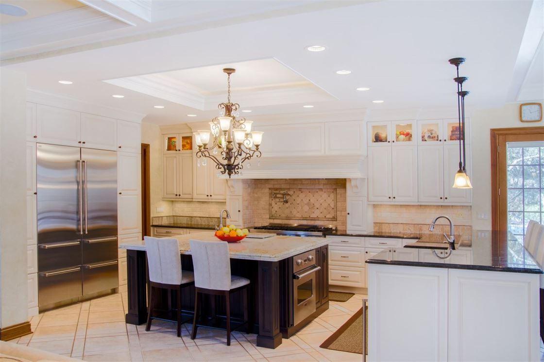 large kitchen with island and breakfast bar