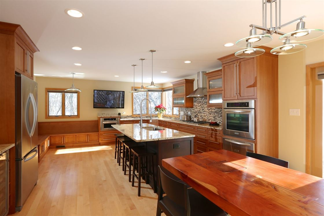 large kitchen with custom built-in seating