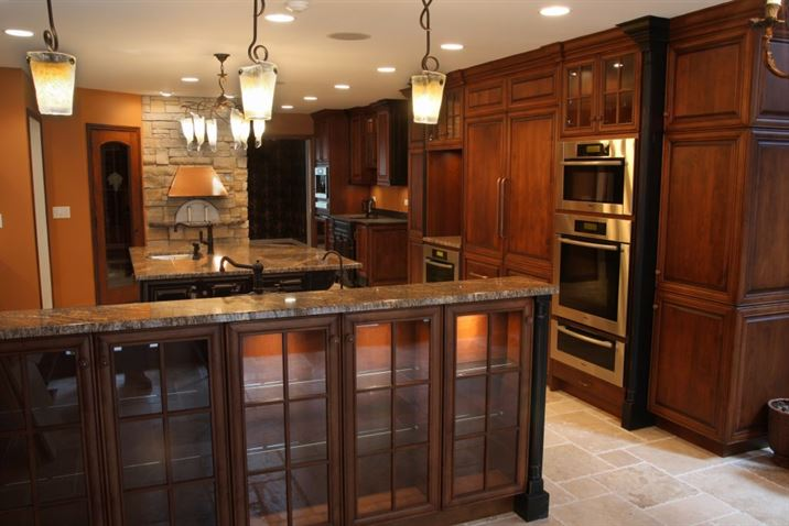 traditional dark wood kitchen with integrated applicances