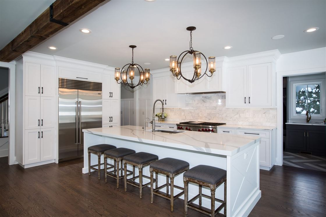 bright white kitchen with eat-in island